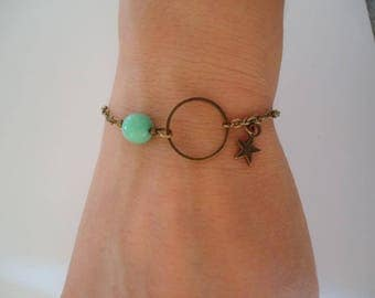 Thin bronze bracelet with a ring, a star and a blue/green bead - Gypsy chic jewelry