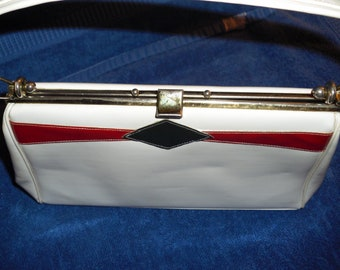 Vintage vinyl white and red and blue plastic purse with clasp open and close