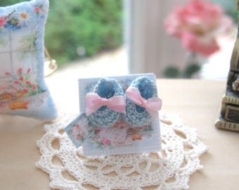 dollhouse baby doll knitted shoes on shop counter display card 12th scale miniature