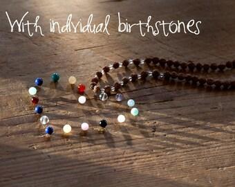 Yoga Mala Necklace with Ayurvedic Rudraksha Seeds, Quartz Crystal and bithstones to harmonize your pregnancy