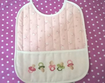 Pink baby bib embroidered pattern nipples