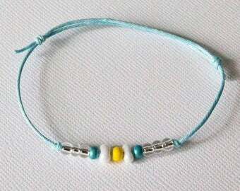 Yellow, white and turquoise adjustable bracelet
