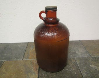 Brown Textured 1 gallon jug ,  Glass jug ,  120 LM & 7 on bottom , No other markings