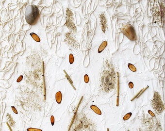 Nature canvas: pebbles, wood, sand and strings