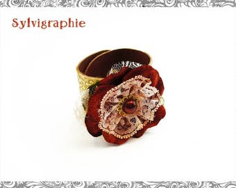 A lace printed leather and flower bracelet