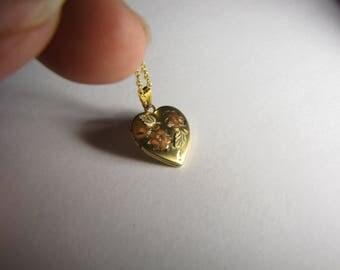 """Black Hills Gold Heart Shaped Locket 1/20 14kt gold with 10k gold trim Landstrom Black Hills Gold """"L"""" logo o"""