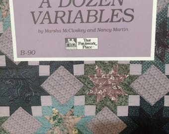 A Dozen Variables quilt book full instructions to make a dozen different quilts not a finished product