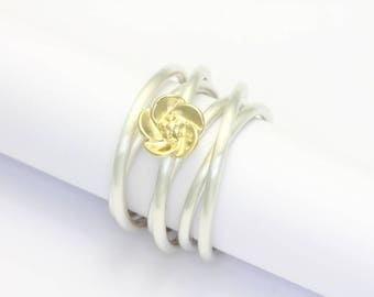 Coiled ring silver with blossom of yellow gold