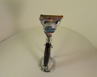Handcrafted  :Fusion (TM)  (Chrome  finished Razor  in a (Black Gold Treasure Lava (TM)Acrylic Blank--with   Chrome Finish Stand)