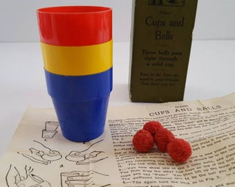 Vintage late 1940's to 1950's Adams' Cups and Balls magic trick, original box, original instructions.