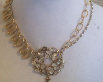 Necklace of repurposed vintage pieces in gold tone.