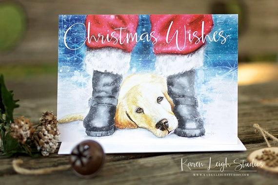 Lab puppy between santas boots