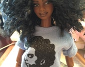 Doll T-Shirt with graphic.
