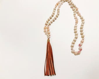 Knotted beaded tassel necklace