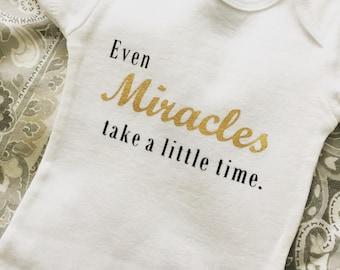 Miracles onesie