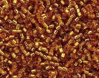 11/0 MIYUKI Delica DB1201 Silver Lined Marigold, 20 grams Dark Topaz