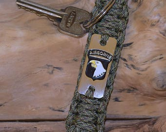 Limited time US Army 101st Airborne key chain key fob in Digital Camo paracord and our large 101st screaming eagle emblem engraved charm