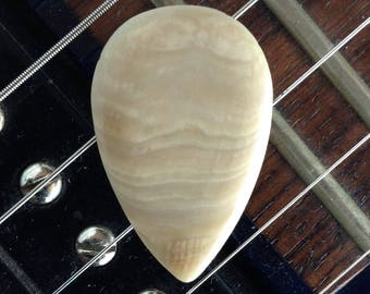SEASHELL GUITAR PICK- teardrop shape, 2.9mm thick, dome grip. Made from actual sea shell.