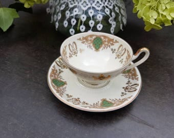 Vintage//Maastricht//Tea Teacup and saucer Mosa//Golden details with green//beautiful motif//second hand dealer//porcelain//eye-catcher!