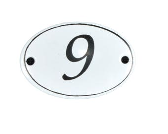 "Plate ""No. 9"" in white and black enamel"