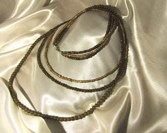 Triple strand beaded necklace in copper tones