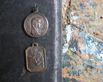 A vintage French religious medal, Mary, St Christopher, St Bernadette