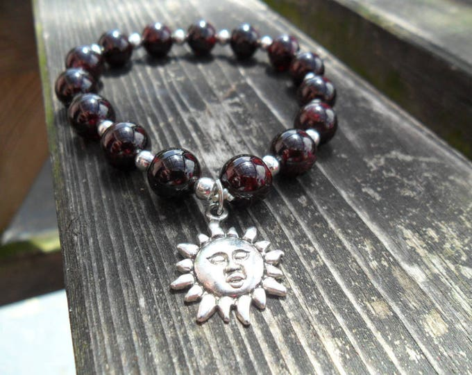 Featured listing image: garnet stretch bracelet with sun charm