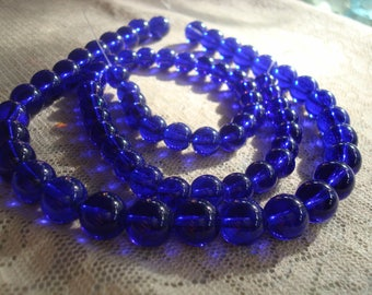 7.5mm & 10mm Deep Cobalt Blue Rounds. Smooth Glass Rounds in Translucent Darkest Blue. Imitation Druk Bead. Full Strands. Saturated Color.