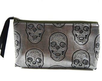 """Bazaar """"skulls"""" faux silver pouch"""