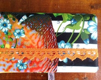 checkbook cover was orange and black with lace pattern