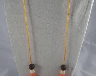 CollierPA014 - Babywearing necklace / nursing, orange and stars