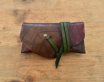 Leather tobacco pouch, engraved with a tobacco leaf