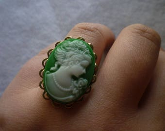 Oval bronze cameo green ring