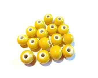 10 handmade ceramic round beads, 10 mm lemon yellow