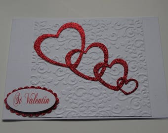 Valentine's day white card four red hearts