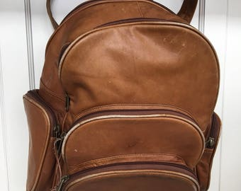 Large tan leather backpack