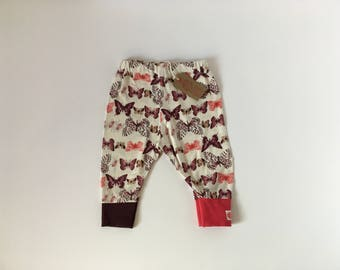 Colourful Butterfly print leggings with contrast cuffs. 6-9 months.