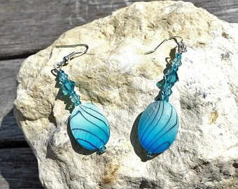Earrings with pearl beads and Swarovski crystals