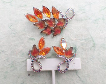 Brooch and clip on earring set bi color leaves AB780