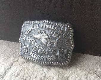 "1986 National Finals Rodeo Belt Buckle, Hesston Youth Belt Buckle, ""Bronc Rider"""