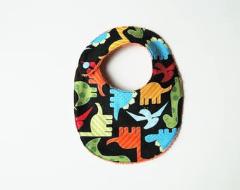 """Bib """"Dinosaurs"""" in cotton and sponge, size birth at 12 months."""