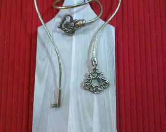 Necklace and bracelet with gilded or silver-plated brass key