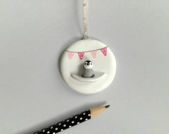 Miniature penguin chick and pink bunting. Little pottery penguin hanger. Hand painted ceramics, new baby girl gift