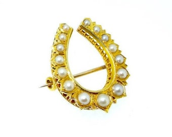 Yellow gold vintage pearl horseshoe brooch