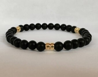 Men's matte onyx bracelet with gold filledroundel beads
