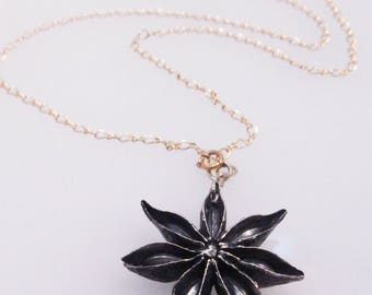 oxidized sterling silver STAR ANISE pendant on contrasting yellow gold chain