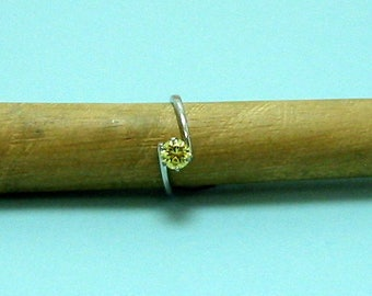 Yellow Cubic Z Faceted Stone mounted into a Sterling Silver Ring Size5 3/4