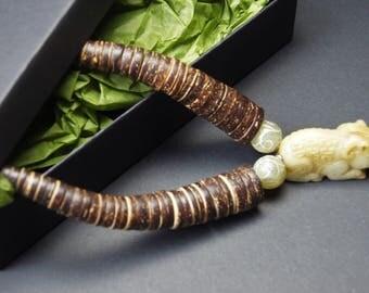 Carved Jade, Ram Pendant,Coconut Heishi Beads, Designer Statement Necklace