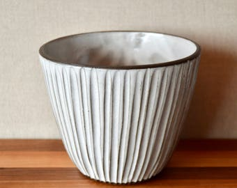 White hand-carved bowl or flower pot