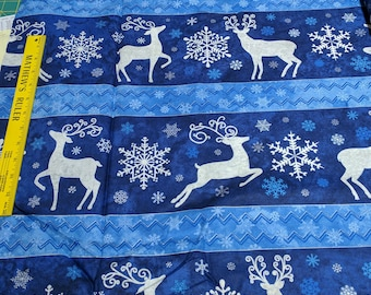 Stonehenge Reindeer Prance-Blue Cotton Fabric from Northcott Studios